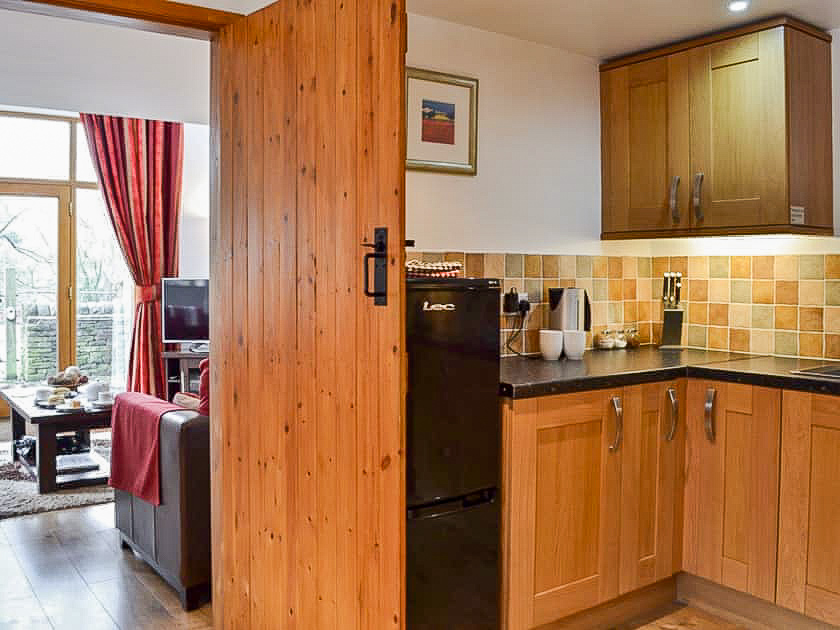 Fully equipped kitchen at Toll Barn Cottage